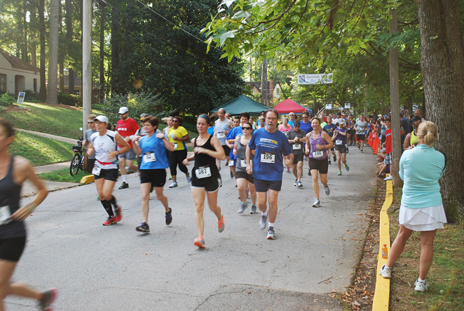 Runners in the Labor day Race run down the street